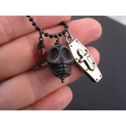 Black Necklace with carved Stone Skull, Silver Coffin Charm and Red Glass Drop